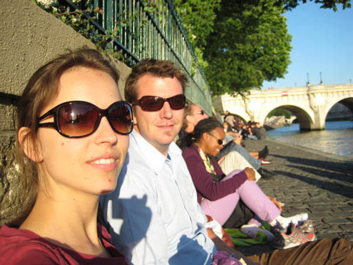 Svetla and Ezra get sun on the Seine - the spot to drink wine as the sun sets in Paris